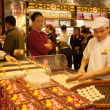 Stock Photo: Confectioner manufactures biscuits in candy store in Macau