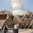 Постер, плакат: Tourists at the Grand Lisboa Casino in Macau