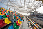 Screaming man with hands up in the seats for spectators — Stockfoto