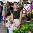Woman visitor from Hong Kong flower shop. — Stock Photo