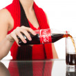 Girl pours a Coca-Cola into a glass — Stock Photo