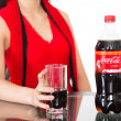 Постер, плакат: Girl holding a glass of Coca Cola