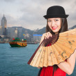 Girl on the background of Hong Kong — Stock Photo