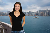 Joyful girl on the background of Hong Kong — Stock Photo