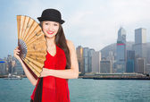 Smiling girl against the backdrop of Hong Kong — Stock Photo
