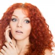Stock Photo: Beautiful red haired girl with surprised look