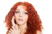 Beautiful red haired girl with a surprised look — Stok fotoğraf