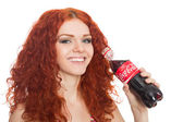 Beautiful girl holding a bottle of Coca-Cola — Stok fotoğraf