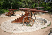Old Russian cannons on wheels — Stock Photo