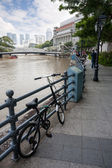 Bicycling on the Boat Quay in Singapore  — Stock Photo