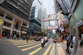 Pedestrians in a crosswalk in the Central district of Hong Kong — Stock Photo