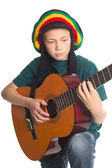 European boy with guitar and hat with dreadlocks — Zdjęcie stockowe