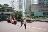 Tourists from Europe at Citibank Plaza in Hong Kong — Stock Photo