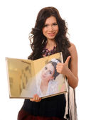 Girl with a wedding photo album. — Stock Photo