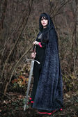 Medieval lady with sword — Stock Photo
