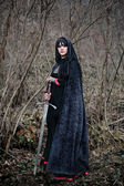 Medieval lady with sword — Stockfoto