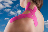 Therapy with kinesio tex tape — Stock Photo