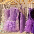 Stock Photo: Glitter dresses in store