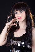 Beautiful brunette on black background — Stock Photo