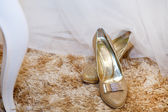 Golden wedding shoes on a carpet — Stock Photo
