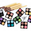Stock Photo: Various eyeshadow palettes, fake eyelashes and cosmetic brushes,