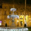 Stock Video: The first fountain at Zrinjevac decorated by Christmas lights.