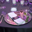 Detail of a wedding dinner setting with purple reflection — Stok fotoğraf