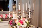 Candle holder decorated with flowers — Stockfoto