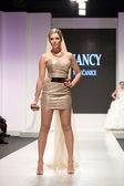 Fashion model in golden wedding dress — Stock Photo