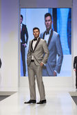 Male fashion model in a suit — Stock Photo