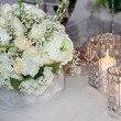 Stock Photo: Table decorated with candles, hydrangeas and white roses