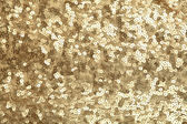 Golden sequins - sparkling sequined textile — Stock Photo