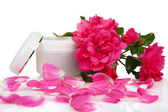 Open jar with the cosmetic cream and rose petals — Stok fotoğraf