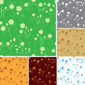 Set - vector seamless patterns with flowers — Stock Vector