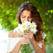 Woman with daisies — Stock Photo #12274822