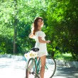 Woman and bicycle — Stock fotografie