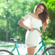 Royalty-Free Stock Photo: Woman and bicycle