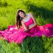 Woman in a long pink dress - Stock Photo