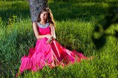 Woman in a long pink dress — Stock Photo