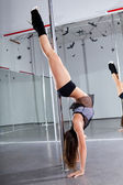 Woman and pole-dance — Stock Photo