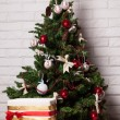 Stock Photo: New Year's tree with toys and gifts