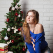 Modern girl near New Year's tree — Stock Photo