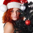 Woman with christmas tree — Stock Photo #4123731