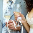 Bride and groom with champagne — Stock Photo #12177623