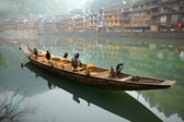 Cormorant birds on the boat. Old Chinese traditional town — Stock Photo