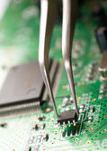 Assembling a circuit board — Stock Photo