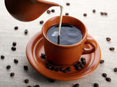 Cup of coffee and cream — Stock Photo