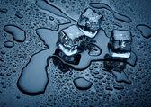Ice cubes over dark background — Stock Photo