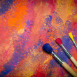 Paintbrushes on abstract grange background — Stock Photo #16333237