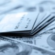 Credit cards on dollars background. Shallow DOF — Stock Photo #16333513